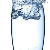 Water splashing into glass